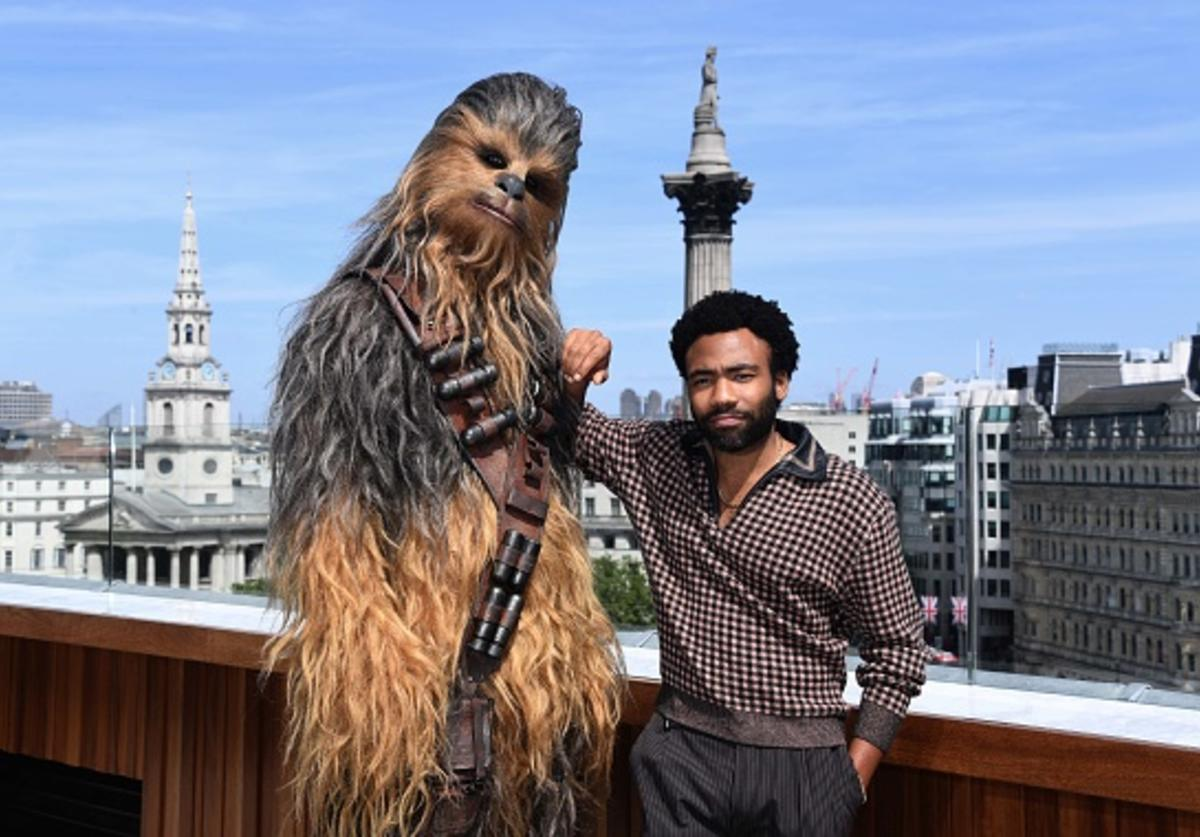 Donald Glover and Chewbacca attend Solo: A Star Wars Story photocall on May 18, 2018 in London, United Kingdom.
