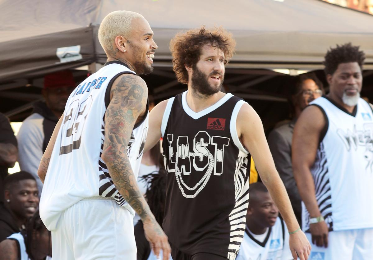 Snoop Dogg and Lil Dicky play basketball during the East Vs. West game at adidas Creates 747 Warehouse St., an event in basketball culture, on February 16, 2018 in Los Angeles, California