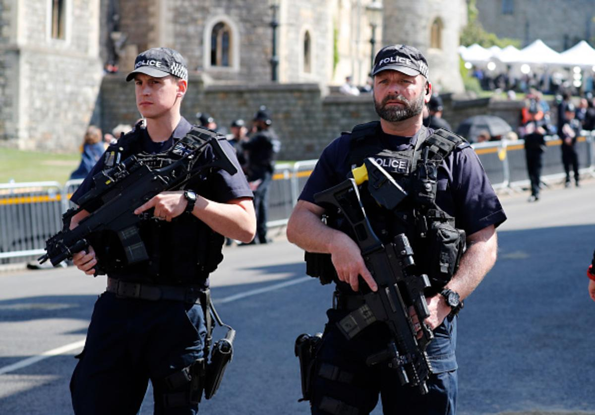 Armed police secure the route of the carriage procession prior to the wedding ceremony of Prince Harry and Meghan Markle at St. George's Chapel in Windsor Castle on May 19, 2018 in Windsor, England.