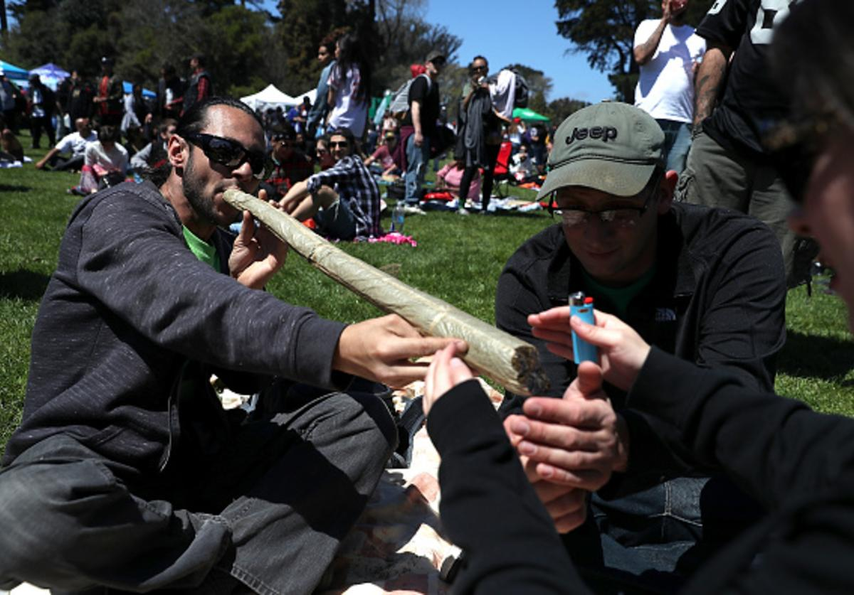 A marijuana user attempts to light an oversized joint during a 420 Day celebration on 'Hippie Hill' in Golden Gate Park on April 20, 2018 in San Francisco, California.