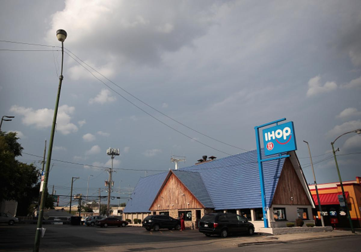 An IHOP restaurant serves customers on August 10, 2017 in Chicago, Illinois. DineEquity, the parent company of Applebee's and IHOP, plans to close up to 160 restaurants in the first quarter of 2018. The announcement helped the stock climb more than 4 percent today.