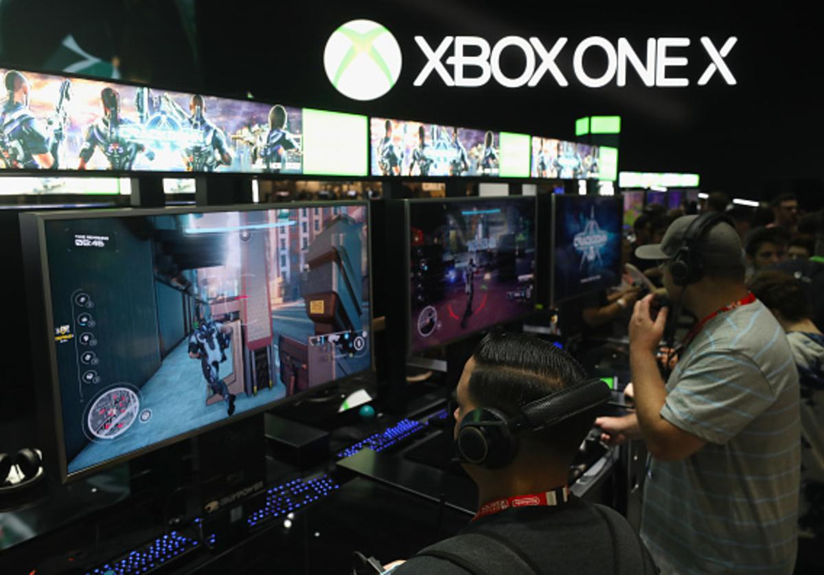 Gamers test 'Crackdown' on the XBox One X during the Electronic Entertainment Expo E3 at the Los Angeles Convention Center on June 13, 2017 in Los Angeles, California.