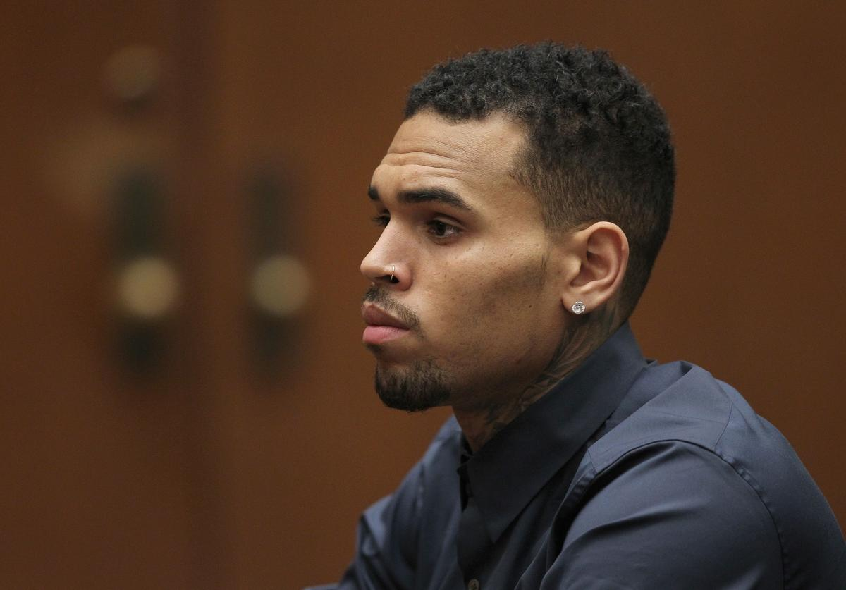 Chris Brown appears in court for a probation progress hearing on February 3, 2014 in Los Angeles, California
