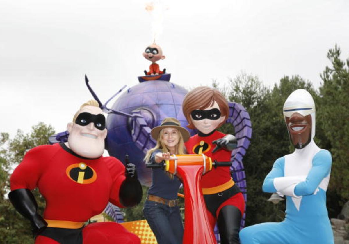 In this handout photo provided by Disney, INCREDIBLE FAMILY REUNION -- Holly Hunter, the voice of Elastigirl in the hit Disney-Pixar film 'The Incredibles,' meets her alter ego along with Mr. Incredible (L) and Frozone during the 'Pixar Play Parade' at Disney's California Adventure on October 27, 2009 in Anaheim, California.