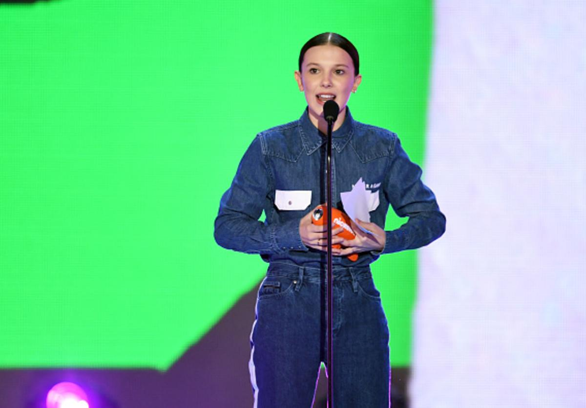 Millie Bobby Brown accepts the Favorite TV Actress award for 'Stranger Things' onstage at Nickelodeon's 2018 Kids' Choice Awards at The Forum on March 24, 2018 in Inglewood, California.