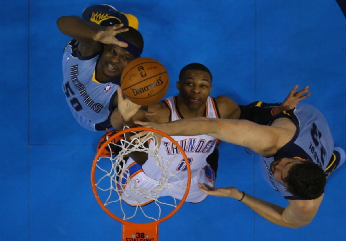 Russell Westbrook #0 of the Oklahoma City Thunder jumps for the rebound with Zach Randolph #50 and Marc Gasol #33 of the Memphis Grizzlies in Game Five of the Western Conference Quarterfinals during the 2014 NBA Playoffs at Chesapeake Energy Arena on April 29, 2014 in Oklahoma City, Oklahoma.