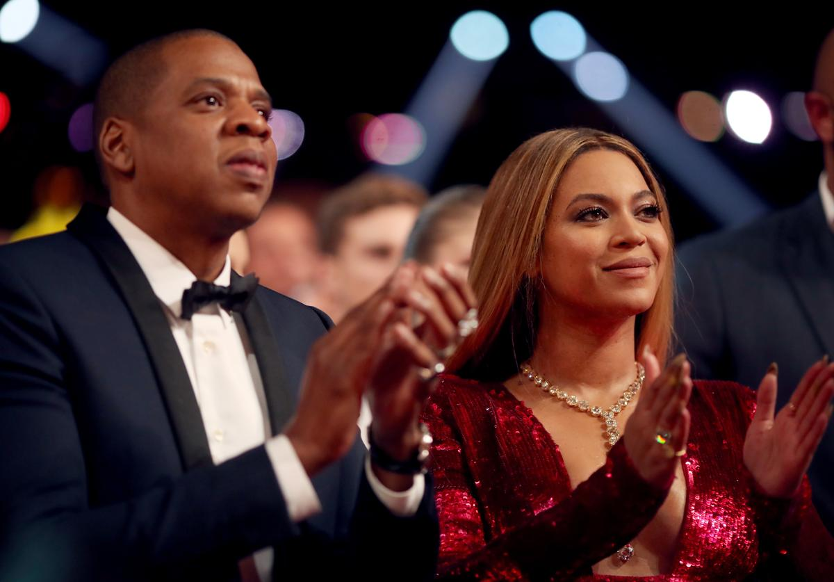 Jay Z (L) and Beyonce attend The 59th GRAMMY Awards at STAPLES Center on February 12, 2017 in Los Angeles, California.