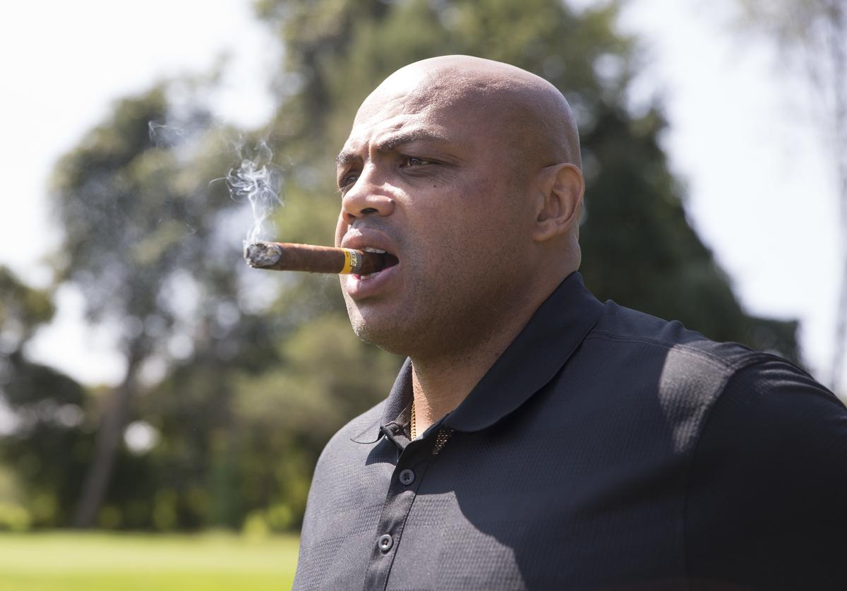 Charles Barkley looks on while smoking a cigar during the Julius Erving Golf Classic at The ACE Club on September 11, 2017 in Lafayette Hill, Pennsylvania