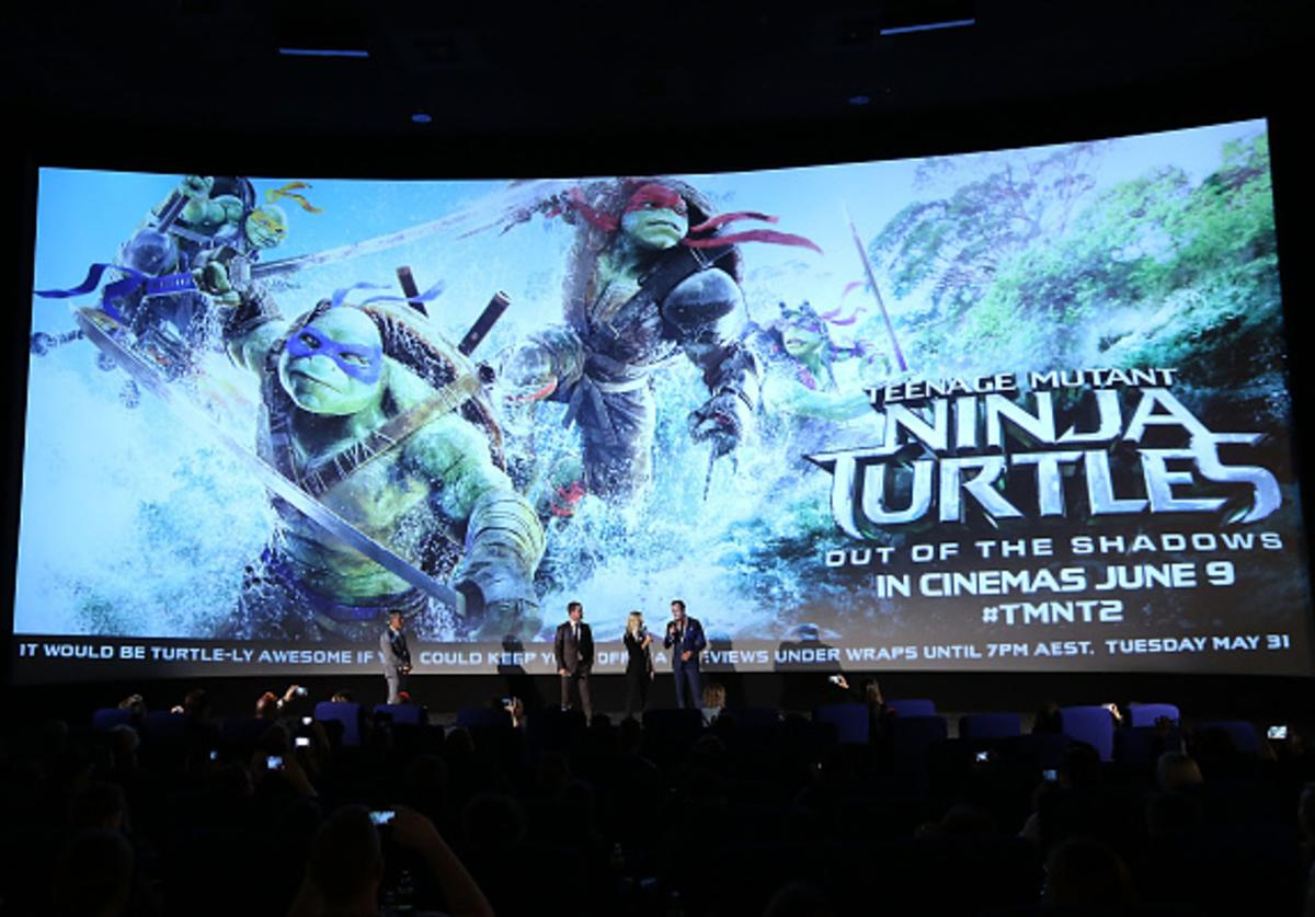 Brad Fuller, Stephen Amell and Will Arnett speak at a fan screening during the Australian premiere of Teenage Mutant Ninja Turtles 2 at Event Cinemas George Street on May 29, 2016 in Sydney, Australia.