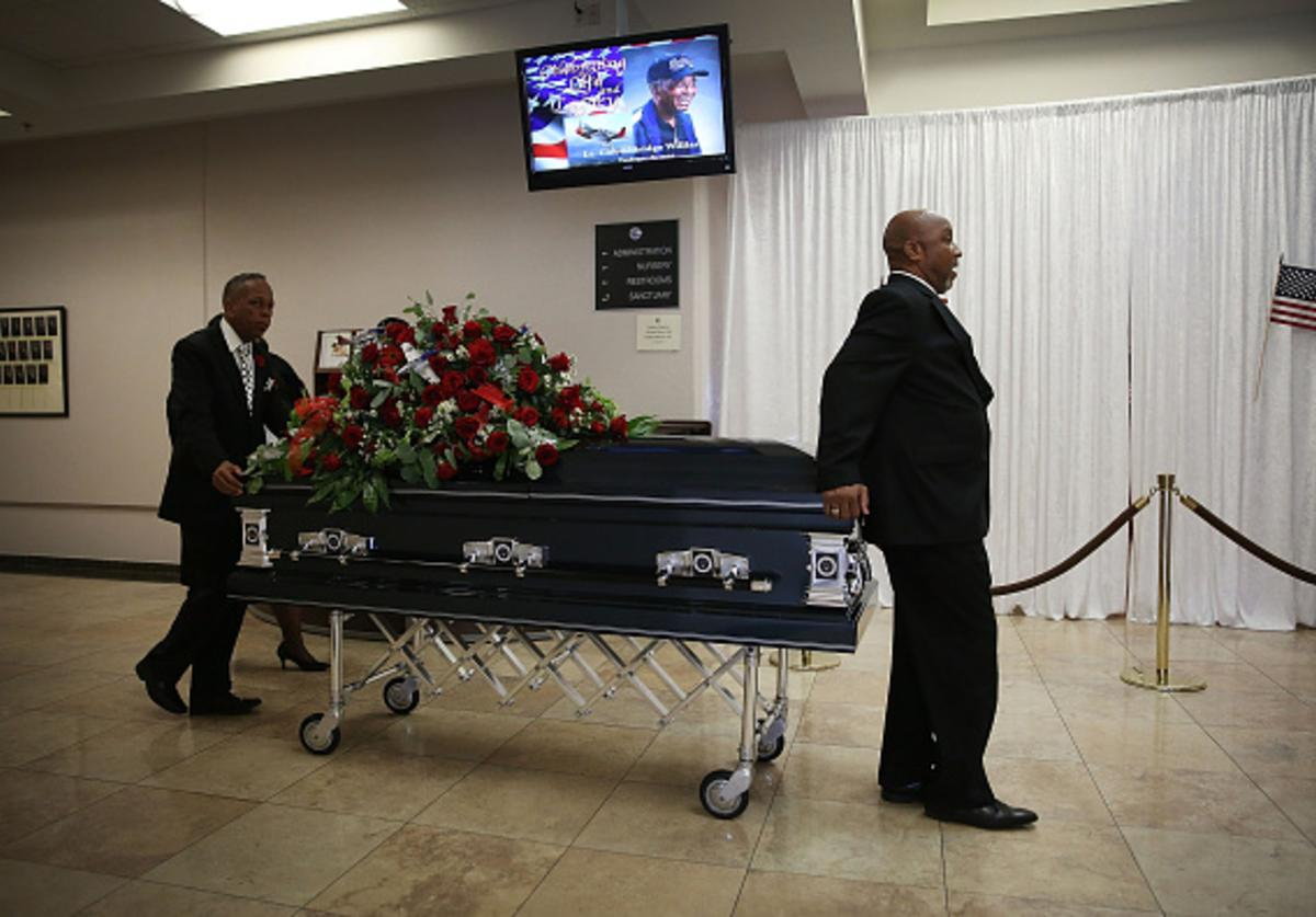 Pall bearers from Paradise Memorial Funeral Home take the casket of retired Air Force Lt. Col. Eldridge Williams to the hearse after a funeral service at the Sweet Home Missionary Baptist Church on July 21, 2015 in Miami, Florida.
