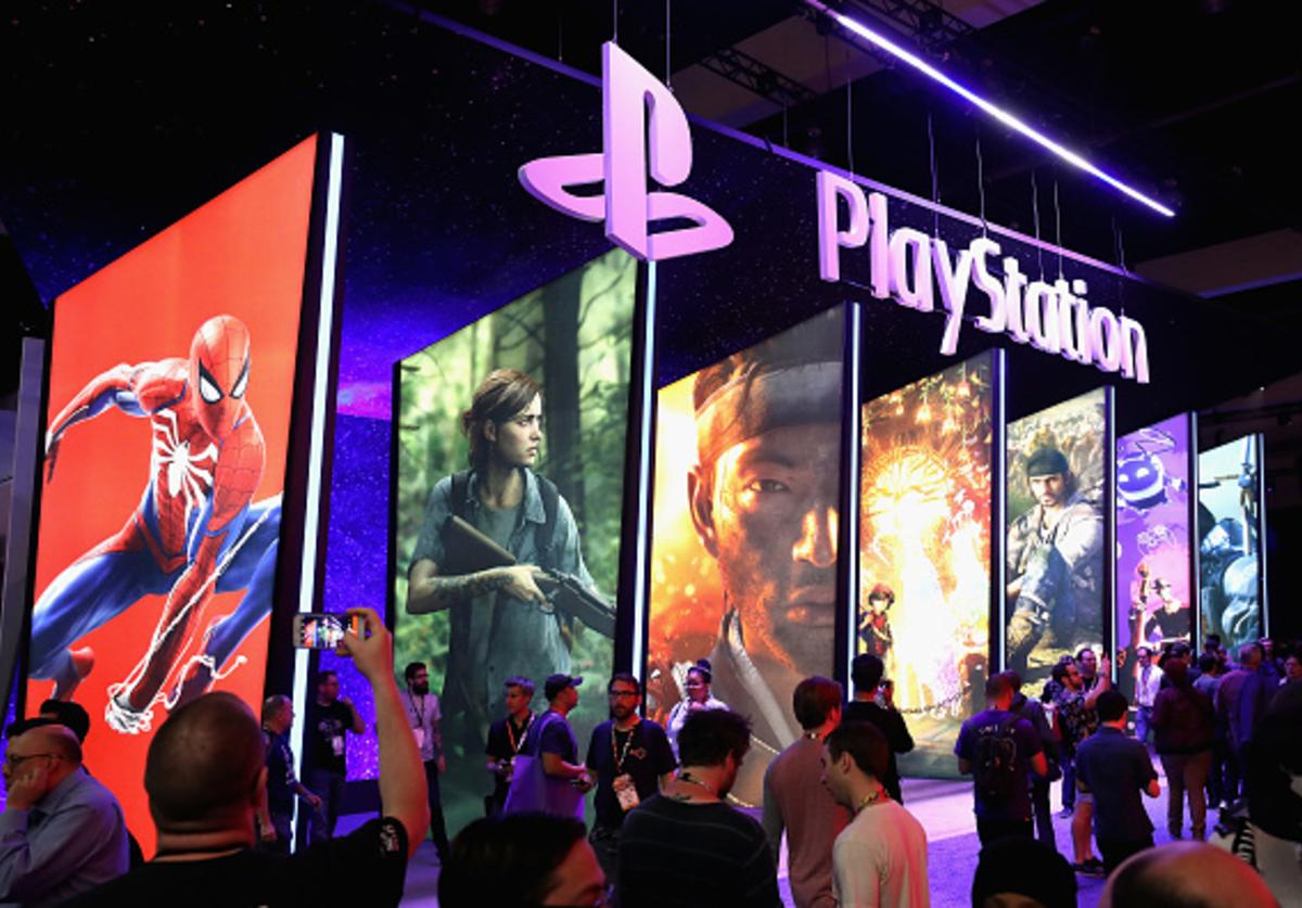 Game enthusiasts and industry personnel visit the 'Sony Playstation' exhibit during the Electronic Entertainment Expo E3 at the Los Angeles Convention Center on June 12, 2018 in Los Angeles, California.