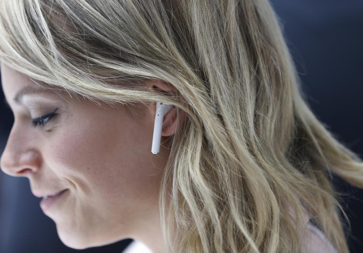 An attendee wears an Apple AirPods during a launch event on September 7, 2016 in San Francisco, California. Apple Inc. unveiled the latest iterations of its smart phone, the iPhone 7 and 7 Plus, the Apple Watch Series 2, as well as AirPods, the tech giant's first wireless headphones.