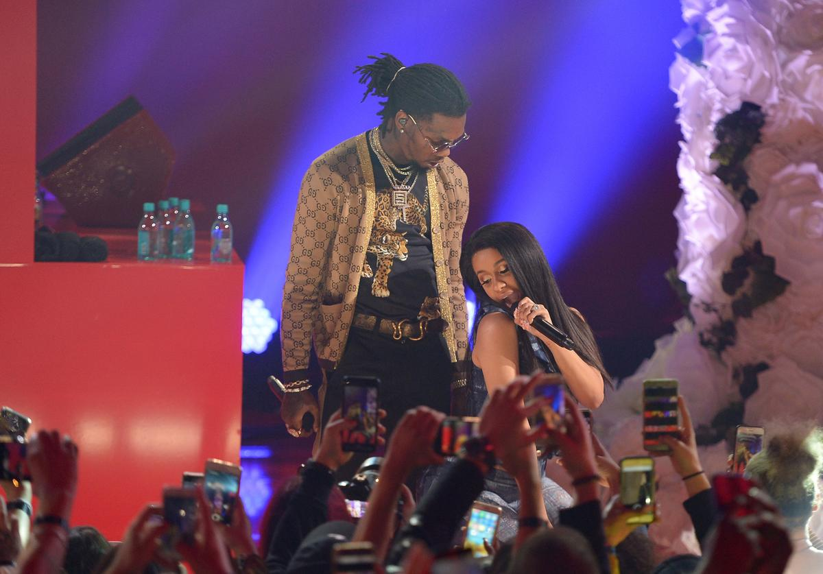 Offset (L) and Cardi B perform onstage at iHeartRadio album release party with Migos presented by MAGNUM Large Size Condoms at iHeartRadio Theater on January 22, 2018 in Burbank, California
