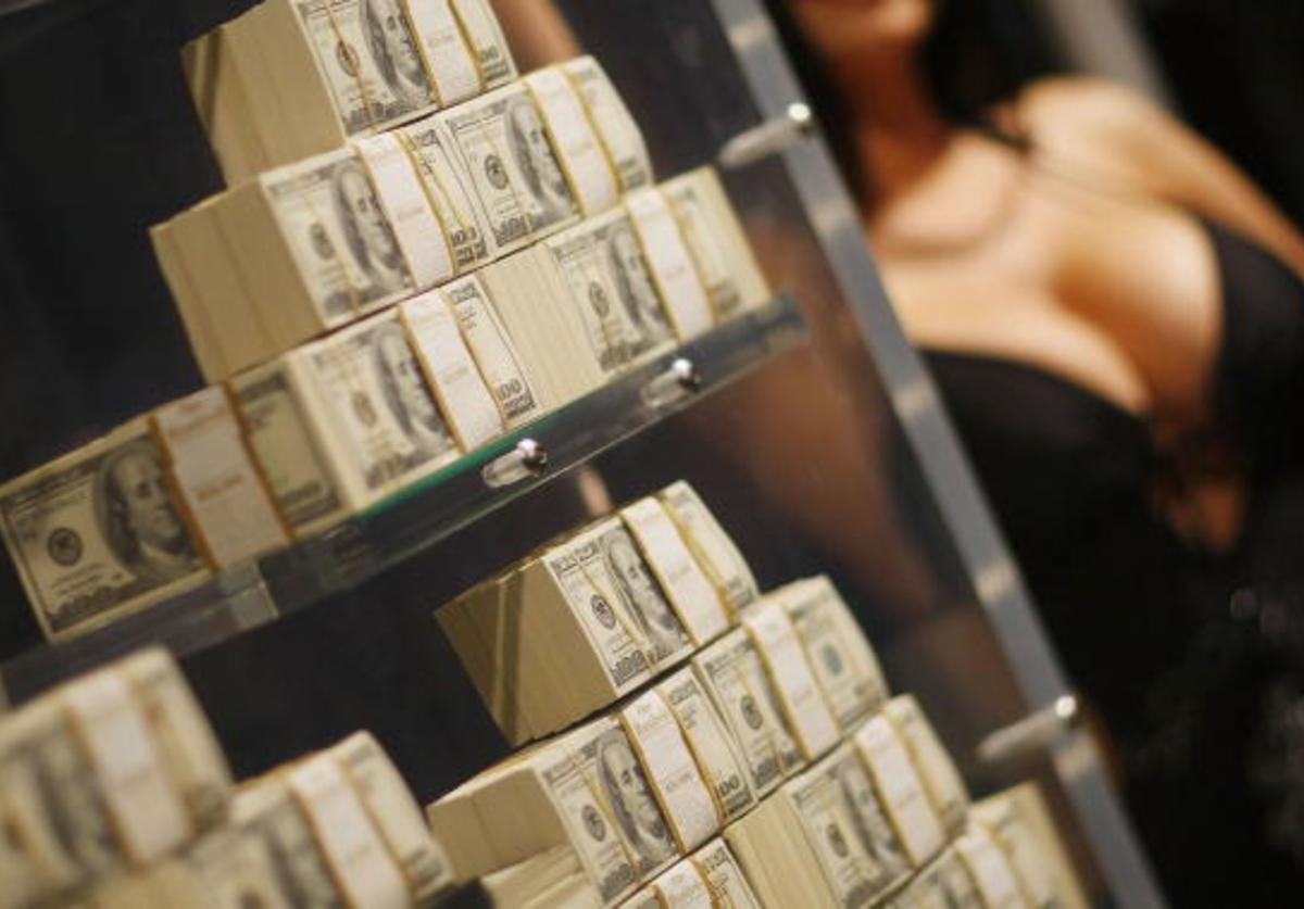 Stacks of money are seen in what is being called a first-of-its-kind exhibit of five million dollars in cash at the Seminole Hard Rock Hotel & Casino on March 18, 2009 in Hollywood, Florida. The display consists of $100 bills encased in a 1,300-pound, custom-made $90,000 bullet-resistant Lexan showcase.