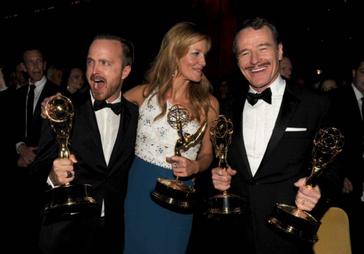 Actors Aaron Paul, winner of the award for Outstanding Supporting Actor in a Drama Series, Anna Gunn, winner of the award for Outstanding Supporting Actress in a Drama Series, and Bryan Cranston, winner of the award for Outstanding Lead Actor in a Drama Series, for the show 'Breaking Bad', attend the 66th Annual Primetime Emmy Awards Governors Ball held at Los Angeles Convention Center on August 25, 2014 in Los Angeles, California.
