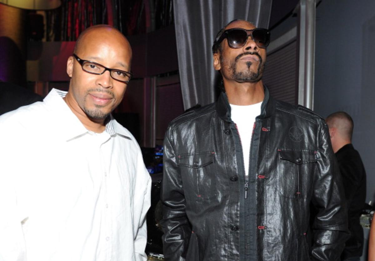 Rappers Warren G (L) and Snoop Dogg attend Snoop Dogg's 40th Birthday Party at The Rolling Stone Lounge on October 18, 2011 in Hollywood, California.