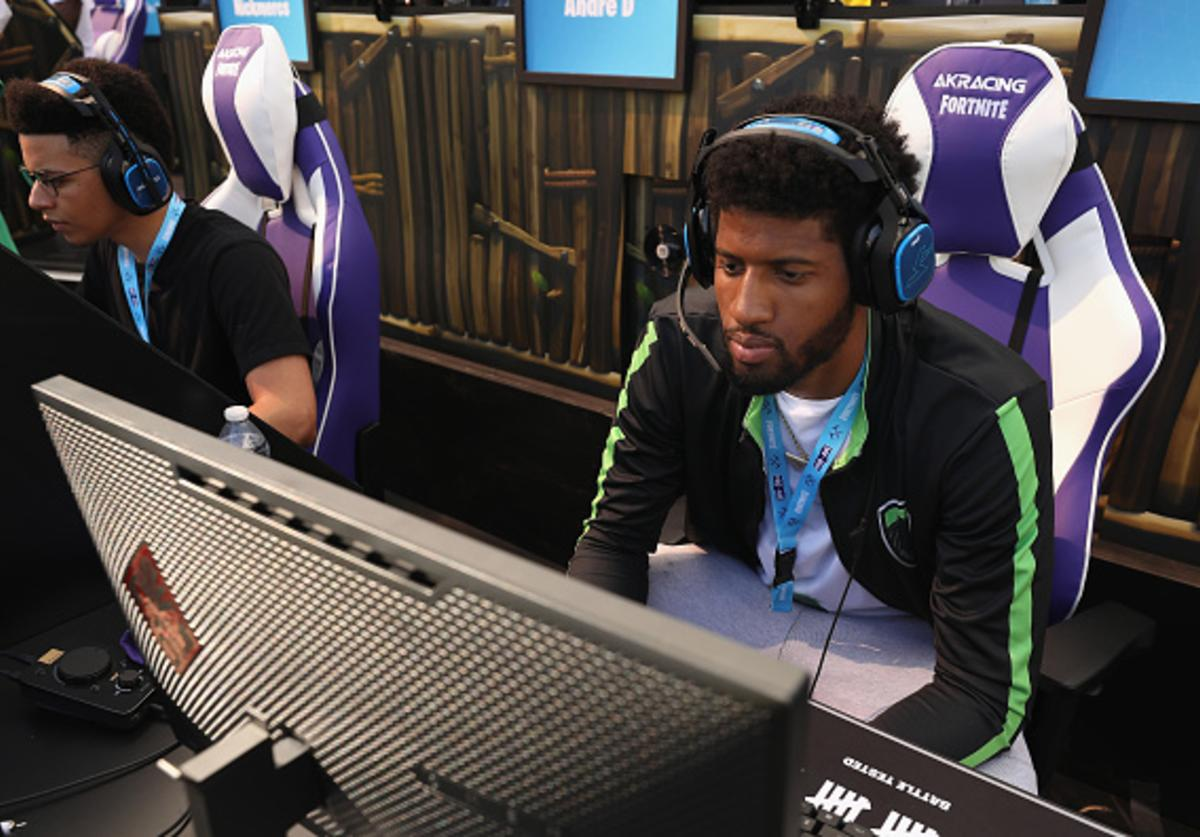 NBA athlete Paul George competes in the Epic Games Fortnite E3 Tournament at the Banc of California Stadium on June 12, 2018 in Los Angeles, California.