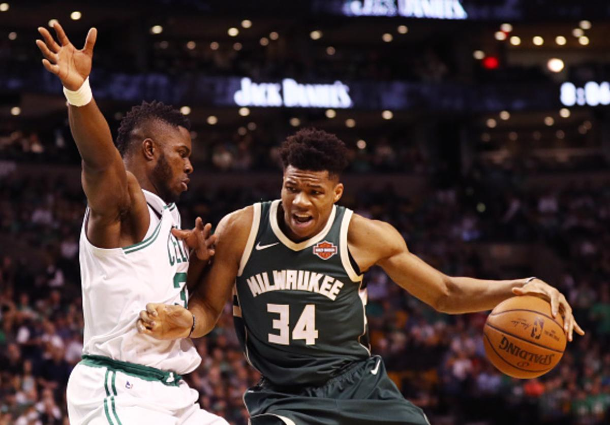 Semi Ojeleye #37 of the Boston Celtics defends Giannis Antetokounmpo #34 of the Milwaukee Bucks during the first quarter of Game Seven in Round One of the 2018 NBA Playoffs at TD Garden on April 28, 2018 in Boston, Massachusetts.