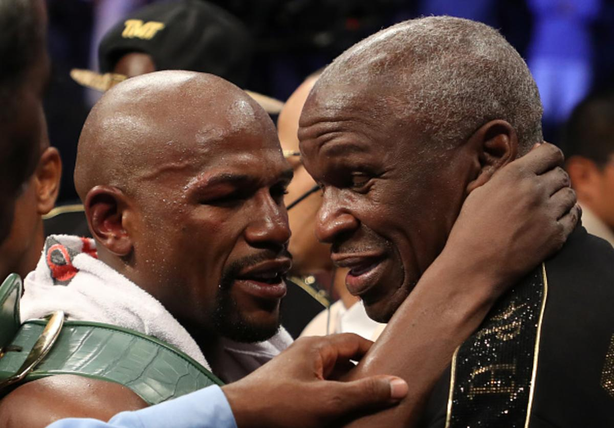 Floyd Mayweather Jr. hugs Floyd Mayweather Sr. after defeating Conor McGregor by TKO in their super welterweight boxing match on August 26, 2017 at T-Mobile Arena in Las Vegas, Nevada.