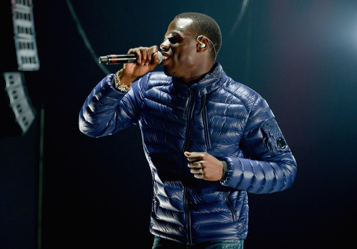 J Hus performs on stage during the Kiss Haunted House Party held at SSE Arena on October 26, 2017 in London, England.