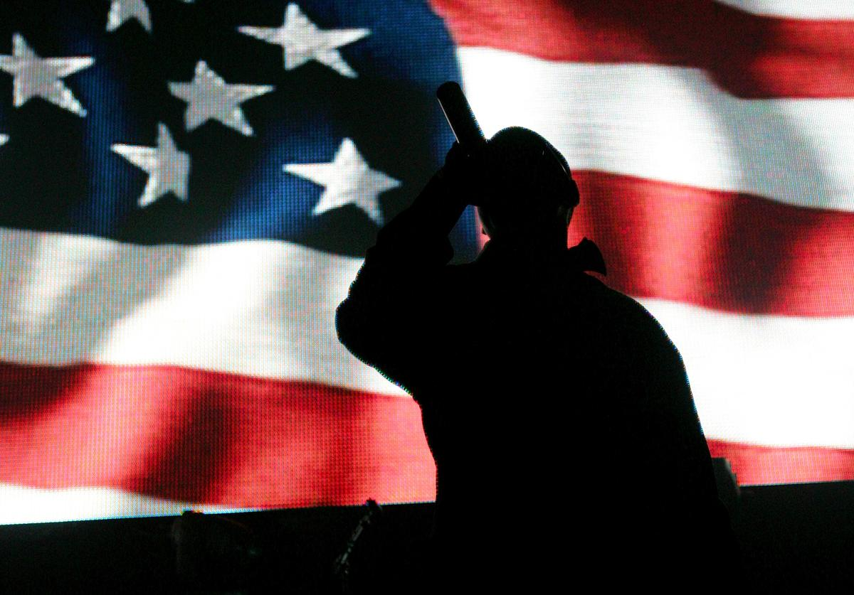 Jay-Z in concert behind the American flag