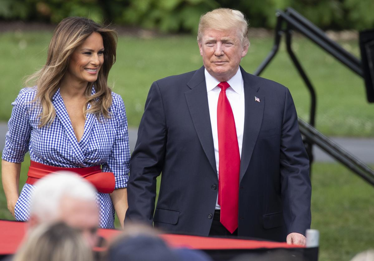 US President Donald Trump and first lady Melania Trump walk on the South Lawn of the White House prior to greeting guests during a picnic for military families on at the White House on July 4, 2018 in Washington, DC.
