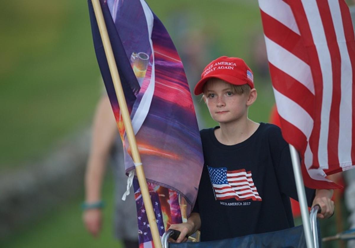 A boy wears a 'Make America Great Again' hat at the Gettysburg National Military Park on July 1, 2017 in Gettysburg, Pennsylvania. The U.S. Park Service issued protest permits for three groups, including Sons of Confederate Veterans, and Real 3% Risen, on the 154th anniversary of the battle.