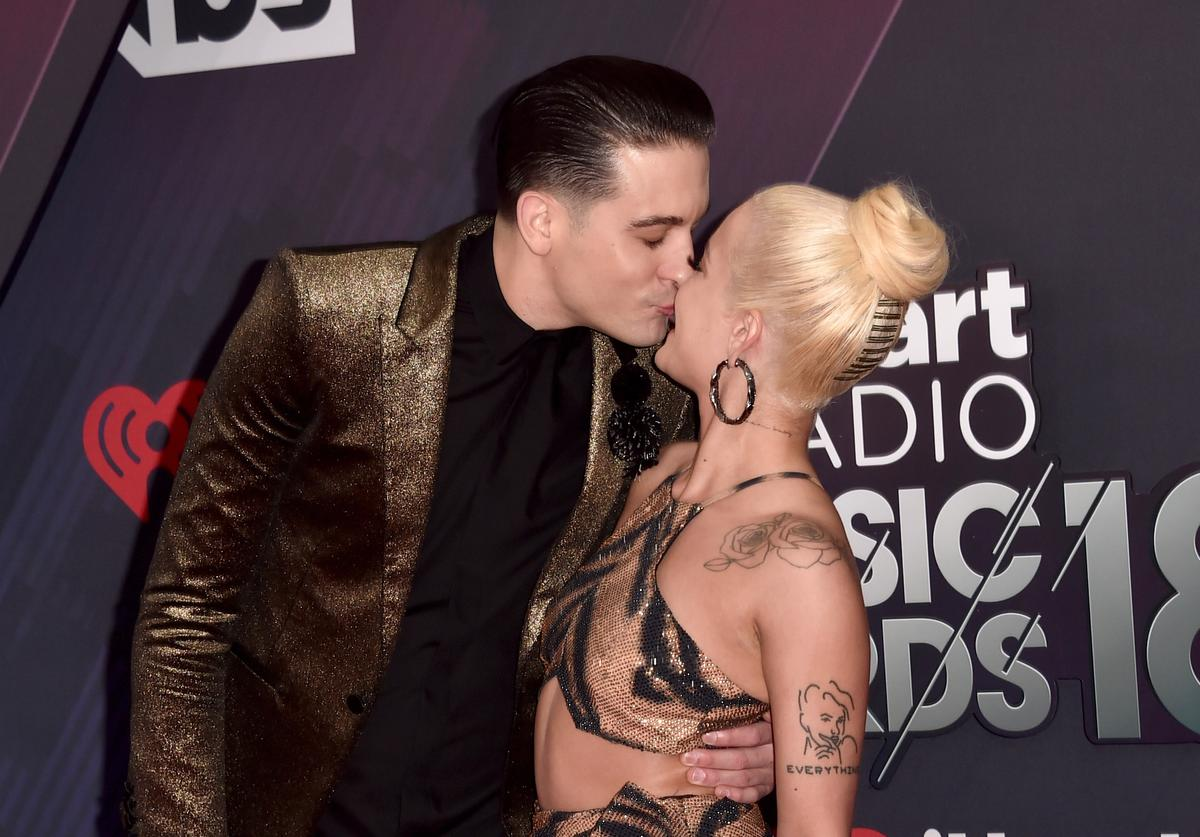G-Eazy (L) and Halsey arrive at the 2018 iHeartRadio Music Awards which broadcasted live on TBS, TNT, and truTV at The Forum on March 11, 2018 in Inglewood, California