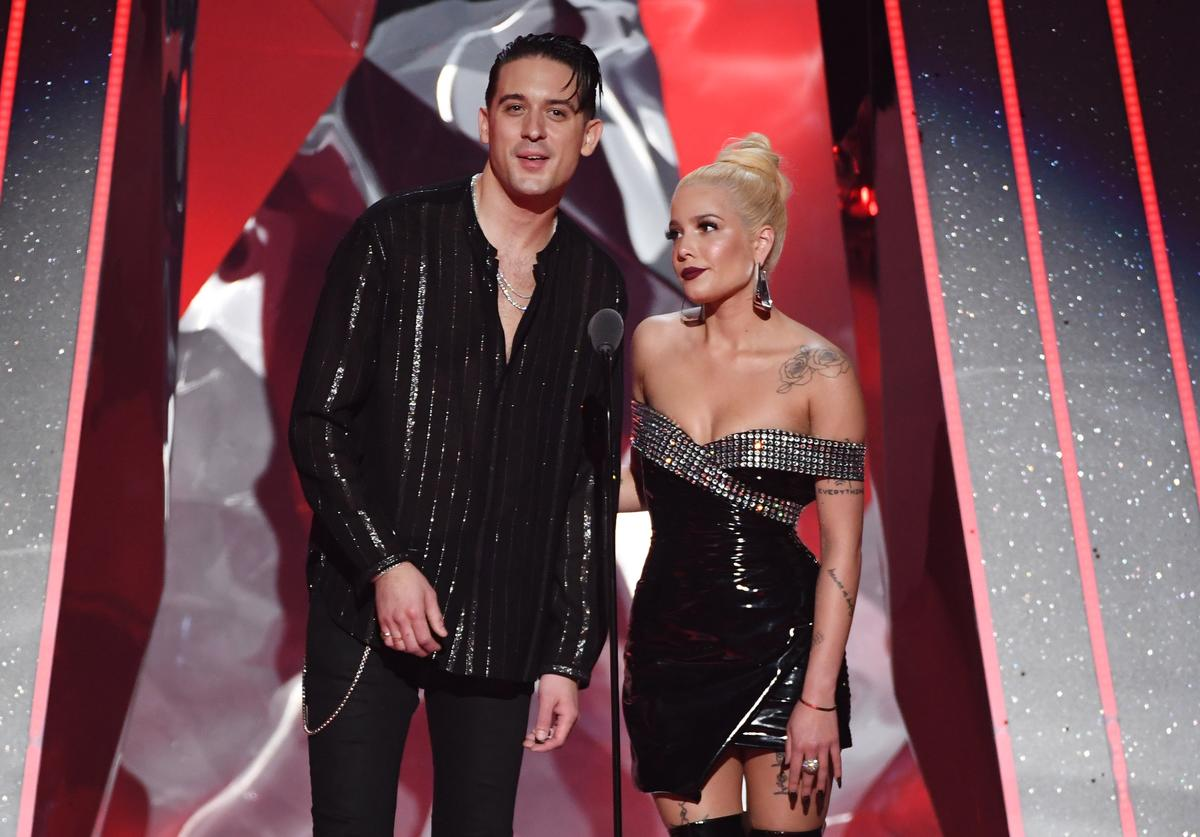 G-Eazy (L) and Halsey speak onstage during the 2018 iHeartRadio Music Awards which broadcasted live on TBS, TNT, and truTV at The Forum on March 11, 2018 in Inglewood, California.