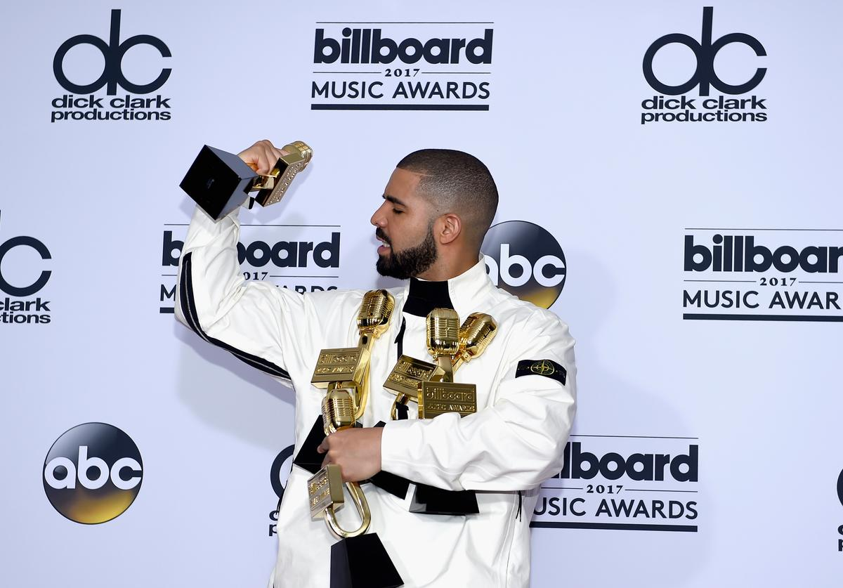 Rapper Drake poses in the press room with his awards for Top Artist, Top Male Artist, Top Billboard 200 Artist, Top Billboard 200 Album for 'Views,' Top Hot 100 Artist, Top Song Sales Artist, Top Streaming Artist, Top Streaming Song (Audio) for 'One Dance,' Top R&B Song for 'One Dance,' Top R&B Collaboration for 'One Dance,' Top Rap Artist, Top Rap Album for 'Views,' and Top Rap Tour during the 2017 Billboard Music Awards at T-Mobile Arena on May 21, 2017 in Las Vegas, Nevada