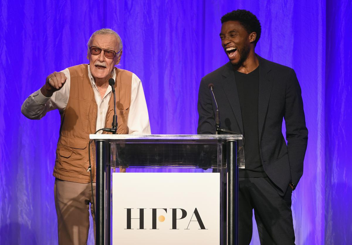 Stan Lee and Chadwick Boseman speak onstage at the Hollywood Foreign Press Association's Grants Banquet at the Beverly Wilshire Four Seasons Hotel on August 2, 2017 in Beverly Hills, California