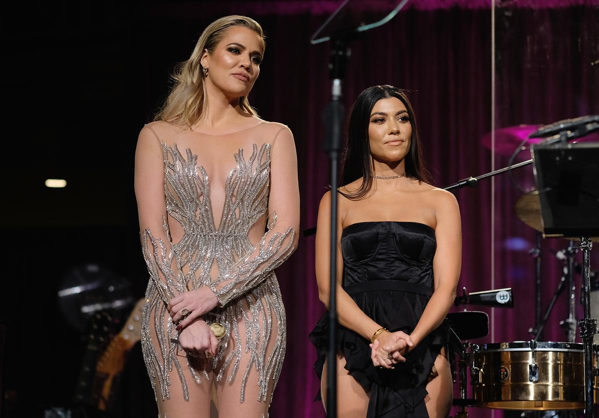 Khloe Kardashian and Kourtney Kardashian onstage at the 2016 Angel Ball hosted by Gabrielle's Angel Foundation For Cancer Research on November 21, 2016 in New York City.