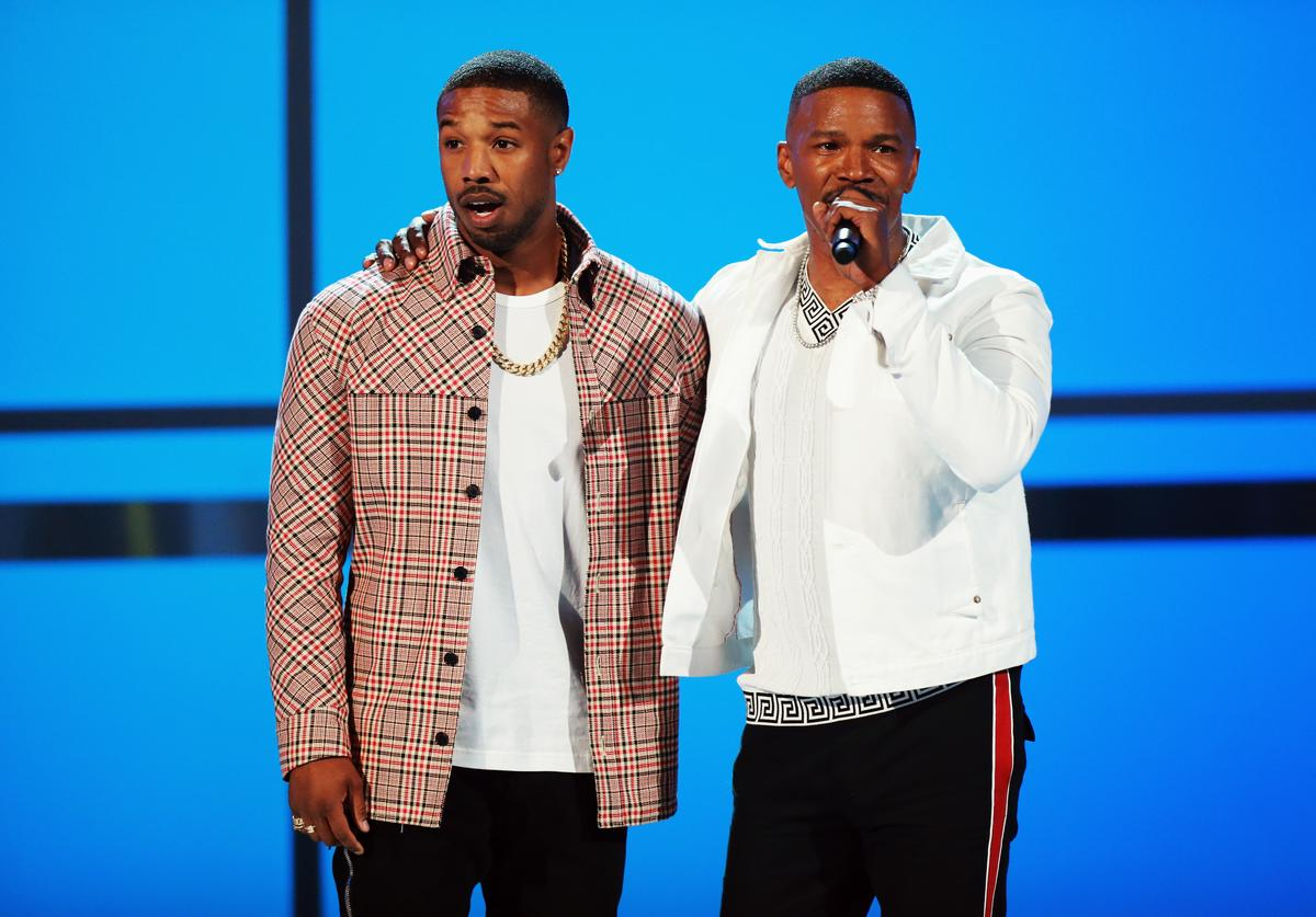 Michael B. Jordan and host Jamie Foxx speak onstage at the 2018 BET Awards at Microsoft Theater on June 24, 2018 in Los Angeles, California.