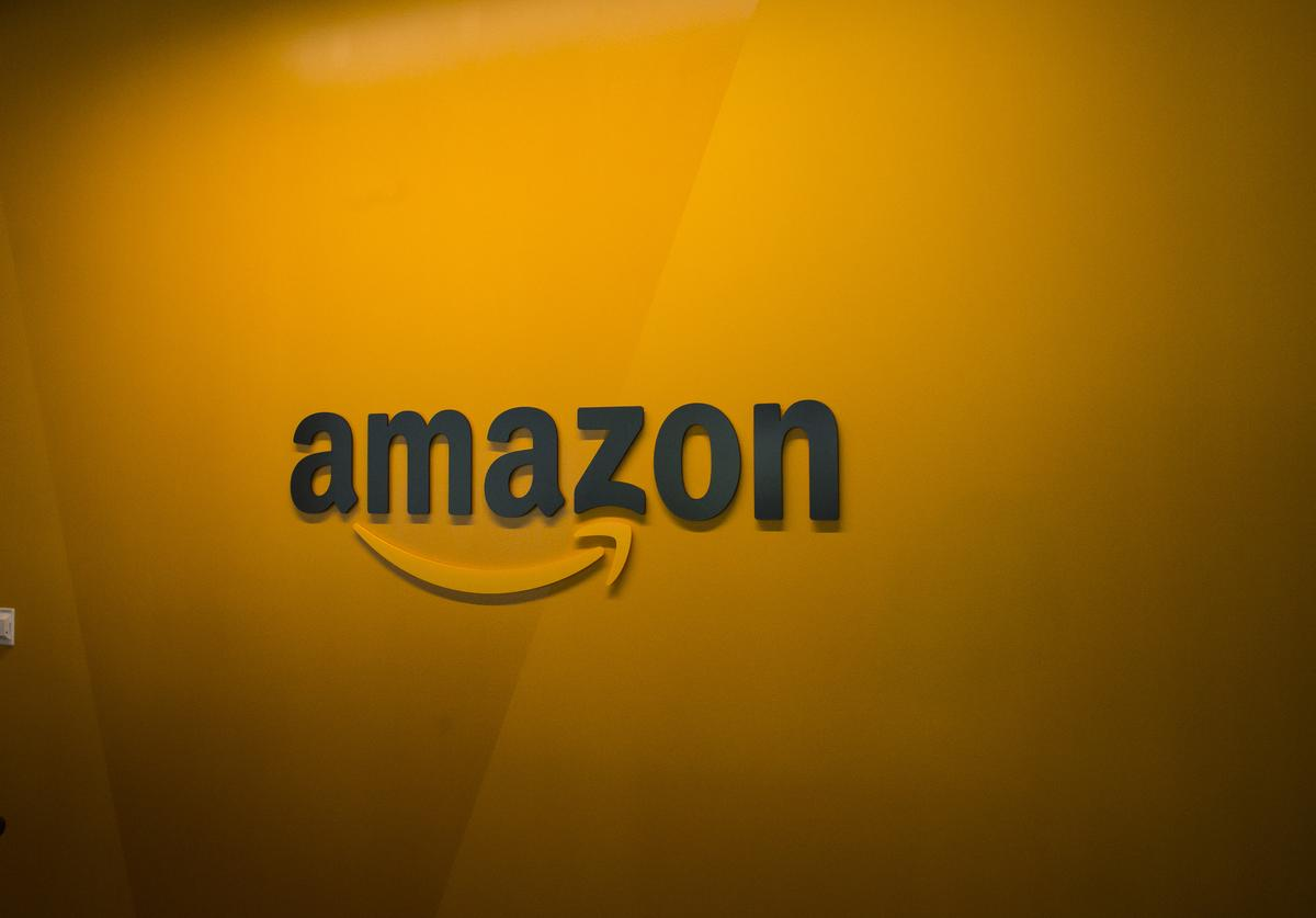 An Amazon logo is seen inside the Amazon corporate headquarters on June 16, 2017 in Seattle, Washington. Amazon announced that it will buy Whole Foods Market, Inc. for over $13 billion.