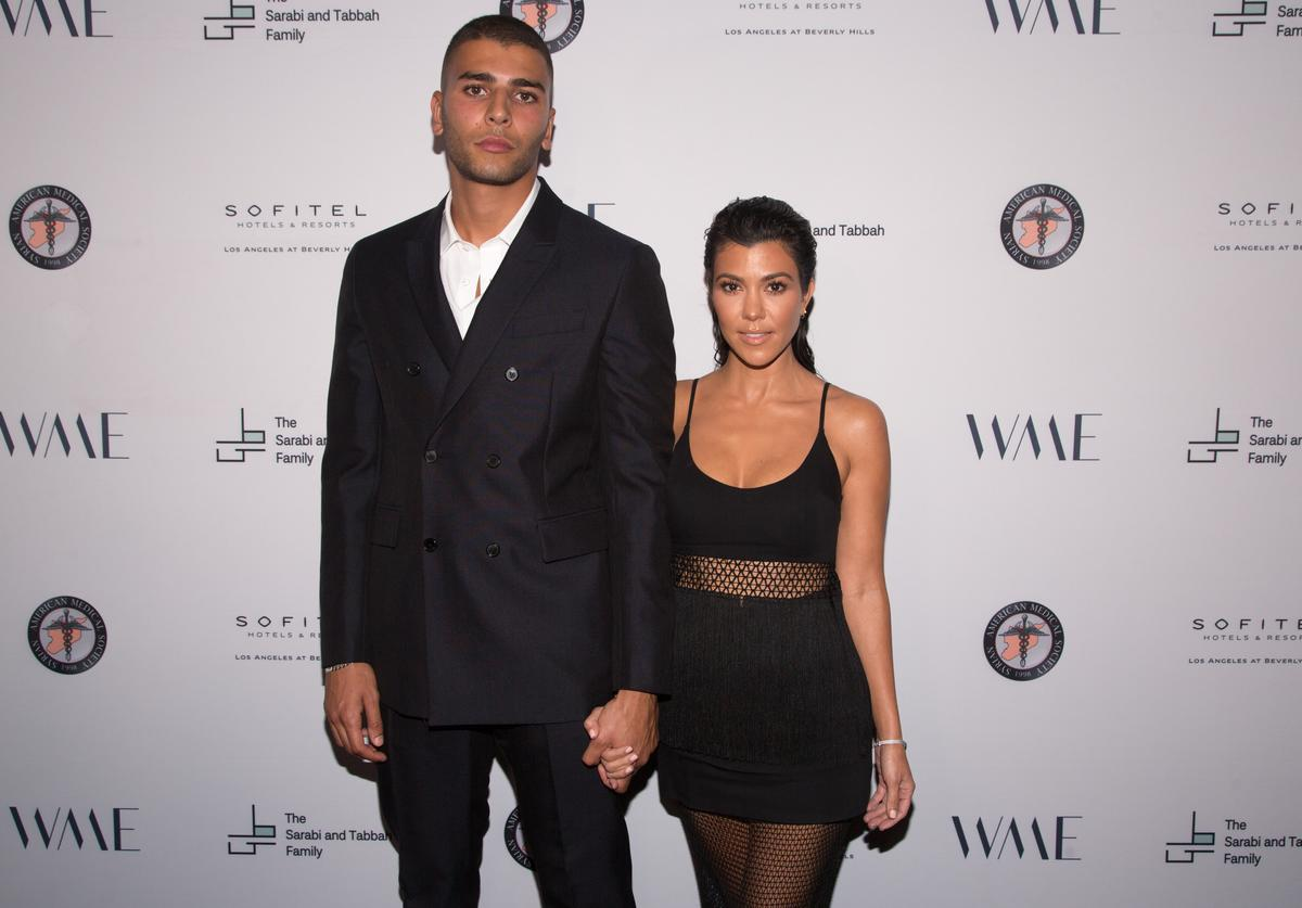 Younes Bendjima (L) and Kourtney Kardashian arrive for The Syrian American Medical Society hosts the Voices in Displacement Gala at Riviera 31 at Sofitel on May 4, 2018 in Los Angeles, California