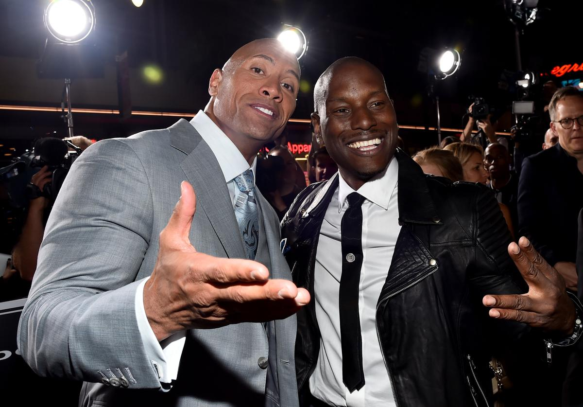 Actor Dwayne 'The Rock' Johnson (L) and recording artist/actor Tyrese Gibson attend Universal Pictures' 'Furious 7' premiere at TCL Chinese Theatre on April 1, 2015 in Hollywood, California.
