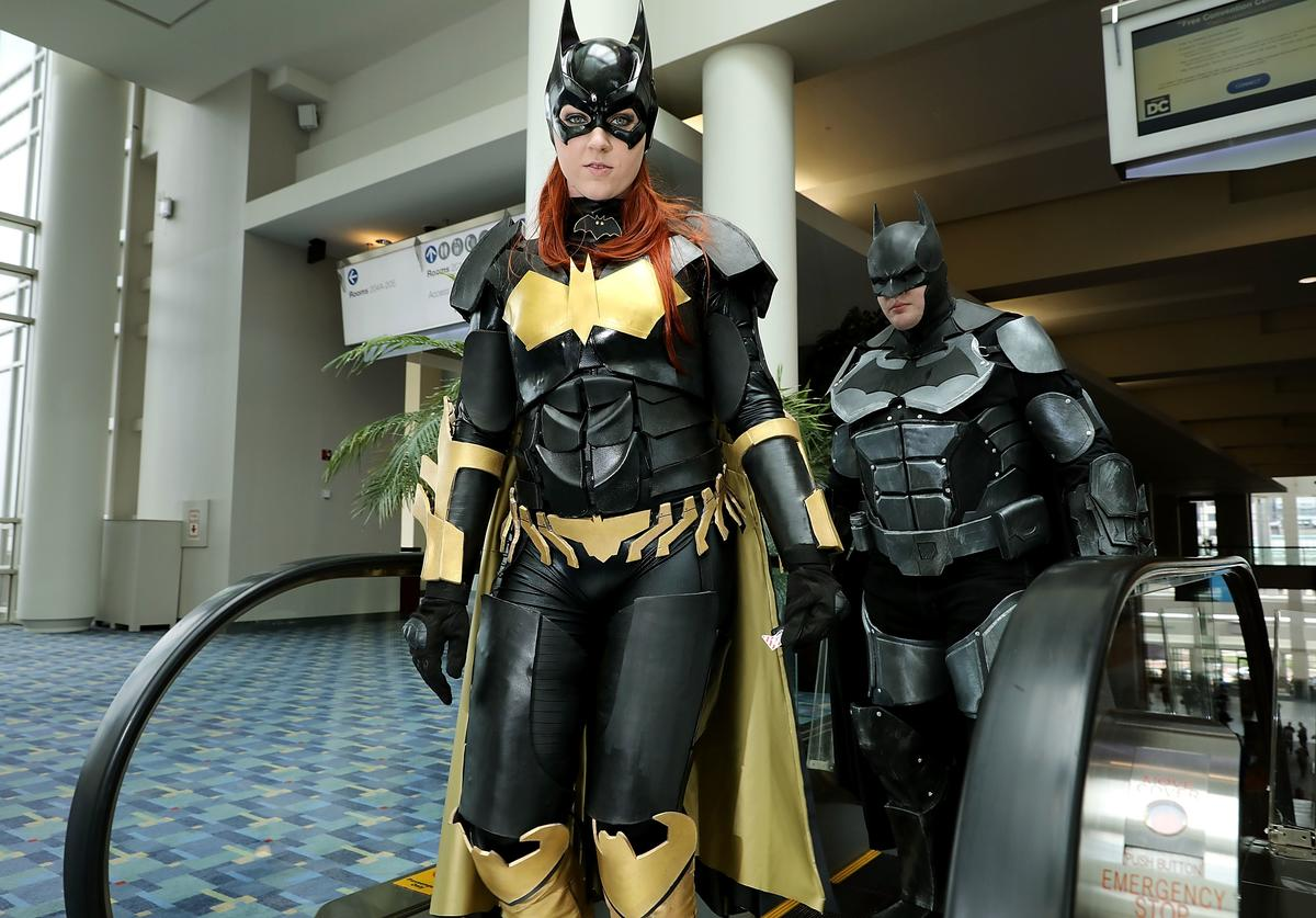 Jessica Jarrett (L) and Duncan Messler of Ignea Cosplay dress as Batwoman and Batman on the first day of Awesome Con at the Walter E. Washington Convention Center June 16, 2017 in Washington, DC. Thousands of fans of popular culture, fantasy and science fiction will gather for the three-day convention that includes comic books, collectibles, toys, games, original art, cosplay and Marvel Comics legend Stan Lee.