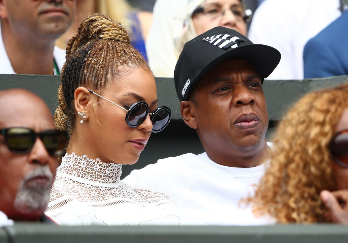 Jay Z and Beyonce watch on as Serena Williams of The United States and Angelique Kerber of Germany play in the Ladies Singles Final match on day twelve of the Wimbledon Lawn Tennis Championships at the All England Lawn Tennis and Croquet Club on July 9, 2016 in London, England