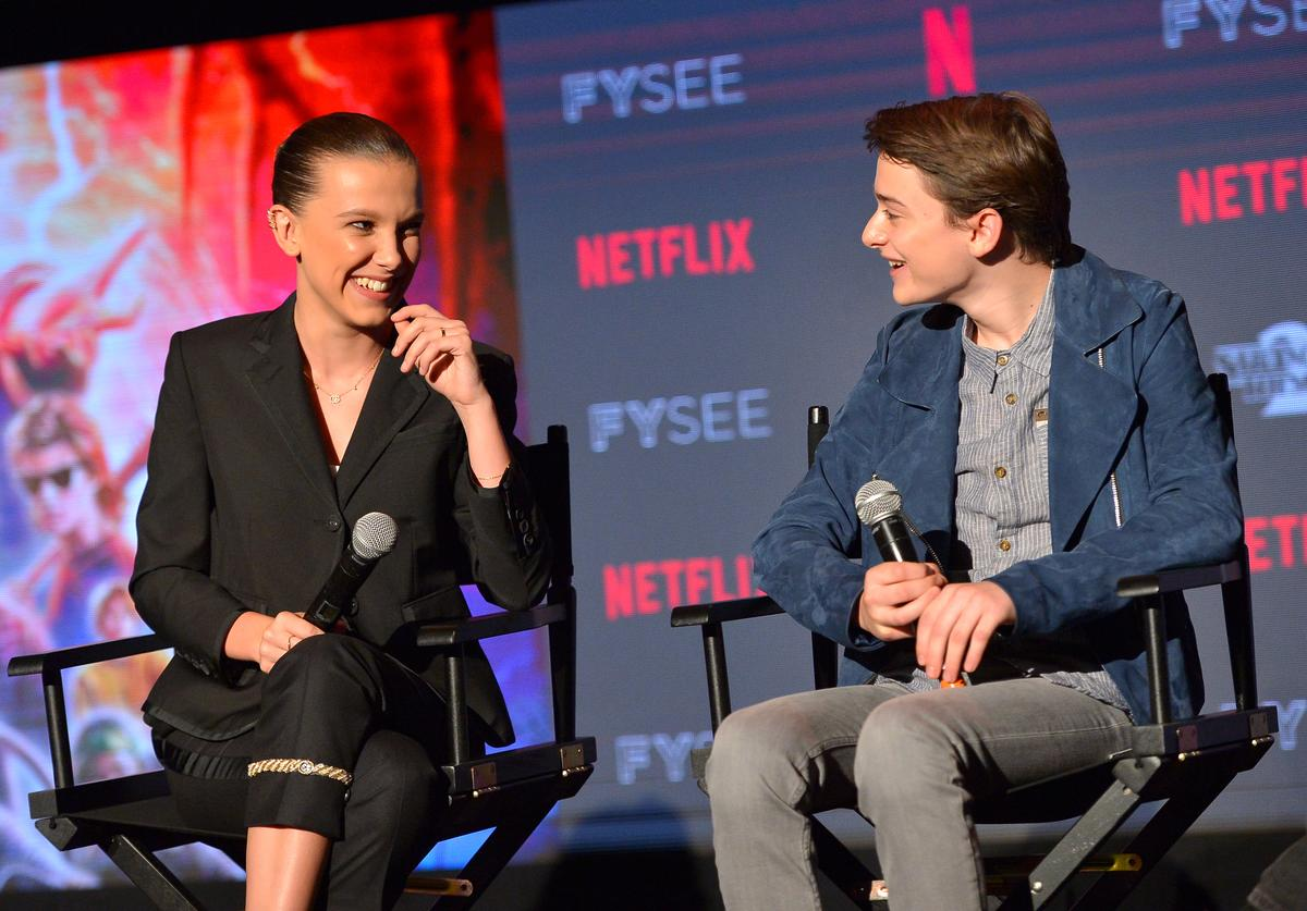 Millie Bobby Brown and Noah Schnapp speak onstage at The 'Stranger Things 2' Panel At Netflix FYSEE on May 19, 2018 in Los Angeles, California