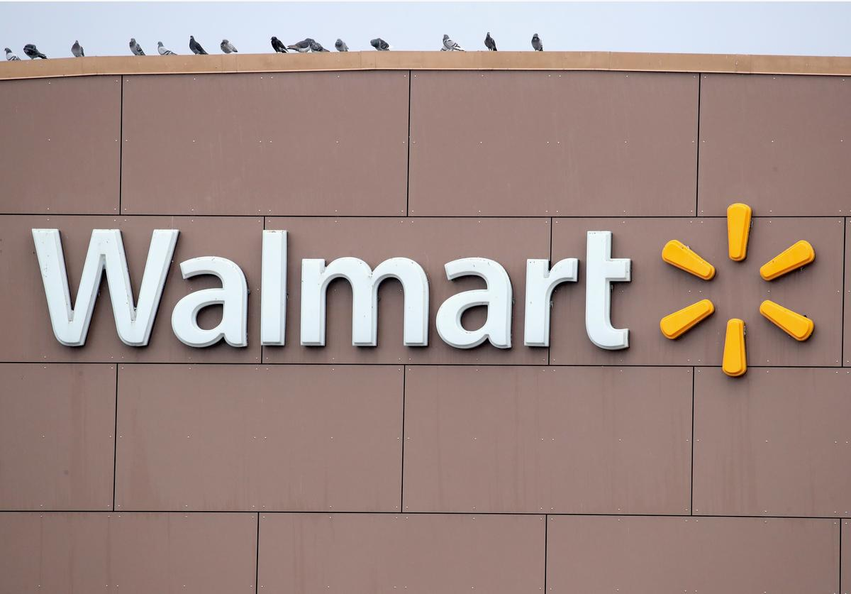 A sign hangs outside Walmart store on January 11, 2018 in Chicago, Illinois.