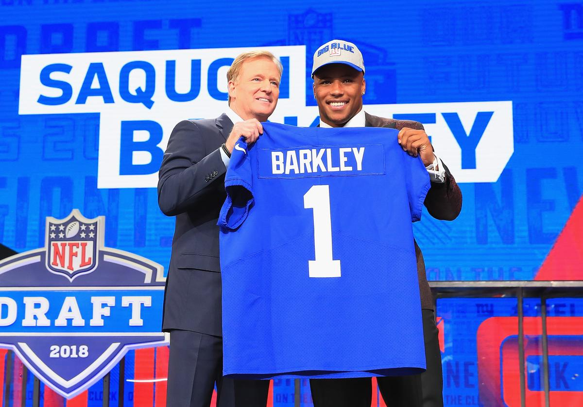 Saquon Barkley of Penn State poses with NFL Commissioner Roger Goodell after being picked #2 overall by the New York Giants during the first round of the 2018 NFL Draft at AT&T Stadium on April 26, 2018 in Arlington, Texas.