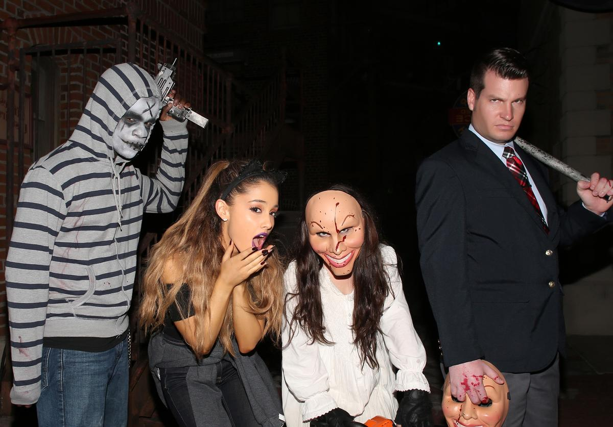 In this handout photo provided by Universal Orlando, pop music sensation Ariana Grande bravely roamed the terrifying streets of Halloween Horror Nights 24 at Universal Orlando Resort with her family and friends on October 30, 2014 in Orlando, Florida.