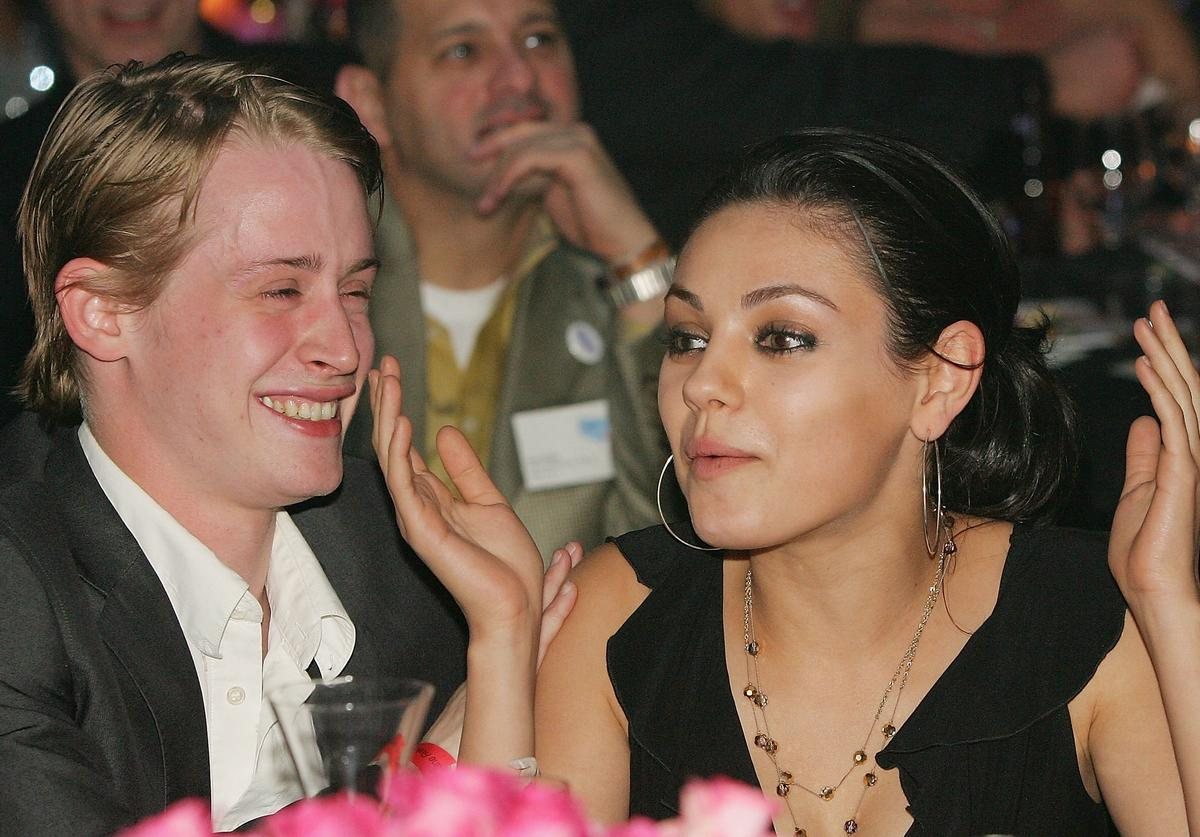 Actor Macaulay Culkin (L) and actress Mila Kunis attend the launch of the 'uBid for Hurricane Relief' charity auction and benefit at the Empire Ballroom October 15, 2005 in Las Vegas, Nevada.