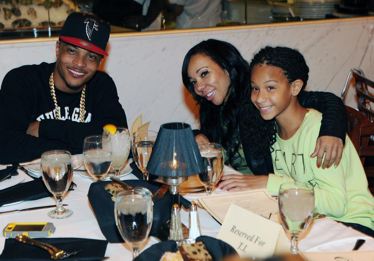 T.I. with Tiny his wife and family at AKOO's 2nd Annual 'A King Of Oneself Brunch' Hosted By T.I. at Ocean Prime on September 30, 2012 in Atlanta, Georgia