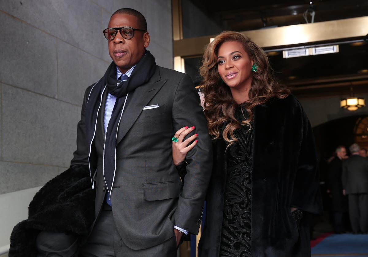Jay-Z and Beyonce arrive at the presidential inauguration on the West Front of the U.S. Capitol January 21, 2013 in Washington, DC. Barack Obama was re-elected for a second term as President of the United States