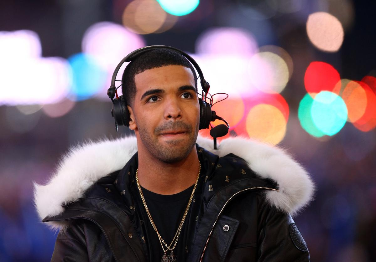 Rapper Drake performs on stage during New Year's Eve 2012 With Carson Daly in Times Square on December 31, 2011 in New York City.