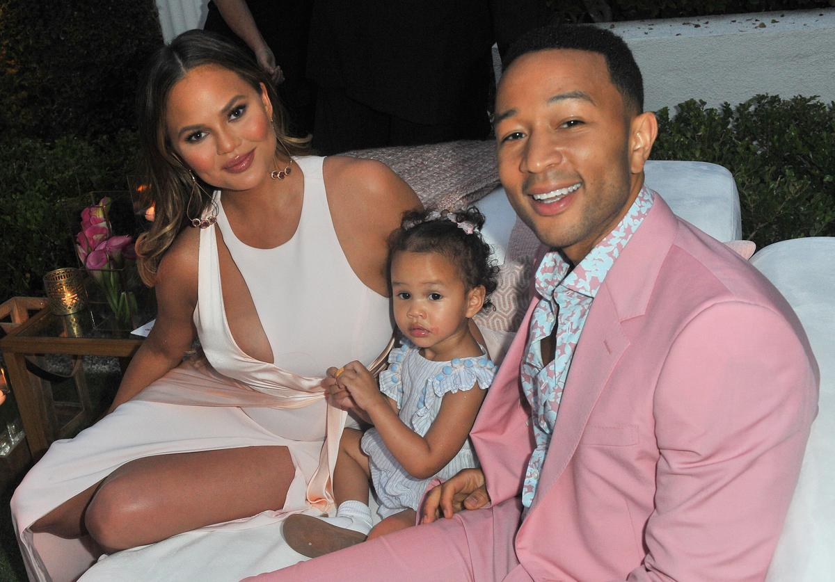 Chrissy Teigen, Luna Simone Stephens and John Legend attend John Legend's launch of his new rose wine brand, LVE, during an intimate Airbnb Concert on June 21, 2018 in Beverly Hills, California