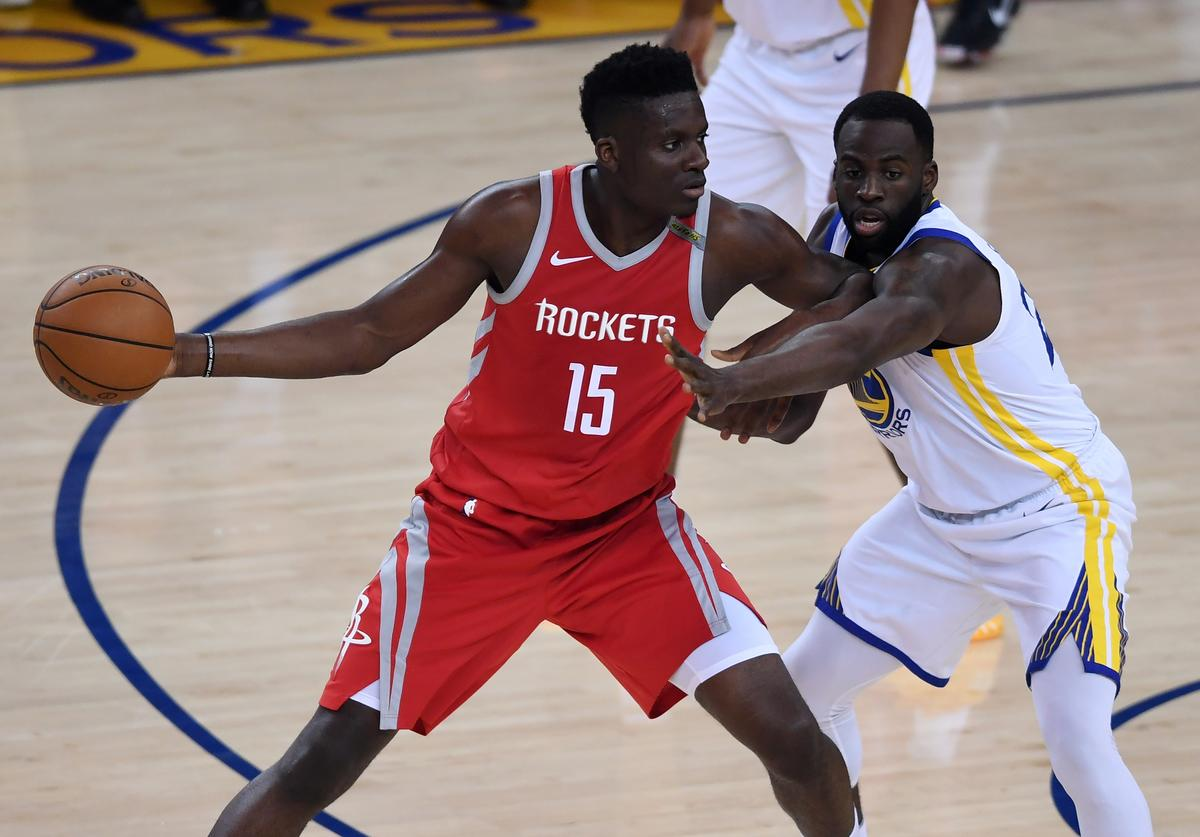 Clint Capela #15 of the Houston Rockets looks to pass against Draymond Green #23 of the Golden State Warriors during Game Six of the Western Conference Finals in the 2018 NBA Playoffs at ORACLE Arena on May 26, 2018 in Oakland, California.
