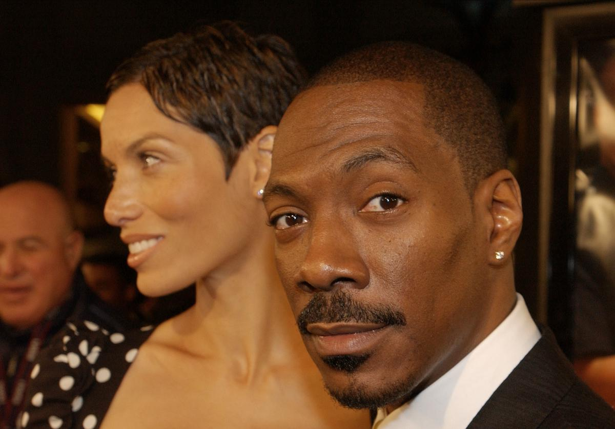 Actor Eddie Murphy and wife Nicole attend the premiere of the film 'Showtime' March 11, 2002 at the Chinese Theatre in Hollywood, CA