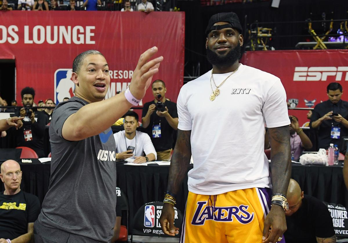 Head coach Tyronn Lue (L) of the Cleveland Cavaliers talks with LeBron James of the Los Angeles Lakers after a quarterfinal game of the 2018 NBA Summer League between the Lakers and the Detroit Pistons at the Thomas & Mack Center on July 15, 2018 in Las Vegas, Nevada